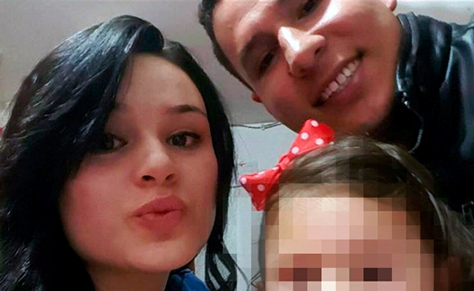 Pic shows: Angie Katerine Herrera and Fray Vicente Ardila Velázquez.nnBy Miruna FantanescunnThis is the shocking moment that a police officer stabbed his pretty pregnant wife to death in a crowded supermarket.nnThe horrific incident was captured on the security cameras of the store in the Colombian capital city of Bogota.nnOther shoppers tried to pull the off duty cop off his wife as he repeatedly stabbed her with a knife.nnThe video footage, which later went viral after being posted online, shows him fighting off two women, knocking one of them to the floor.nnThe police officer, whose name has not been released, then ran from the store leaving his wife, Angie Katerine Herrera, for dead.nnBut he was grabbed by eyewitnesses and passersby who held him until police officers arrived to arrest him.nnThe policeman had followed his wife to the supermarket in the Tunjuelito area of the city after they argued at home earlier that day.nnFriends and neighbours said the couple had not been getting on well for some weeks.nnThe police officer, who was on leave, is being held in police custody and faces murder charges.nnBogota was considered one of the most violent cities in the world in the 1990s but is much improved following a ban on carrying guns in public.nn(ends)