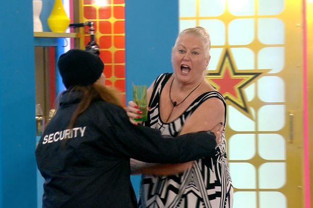 Kim Woodburn was escorted into a spare room following a blazing row (Picture: Channel 5)