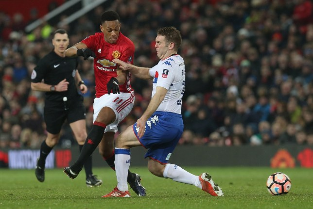 MANCHESTER, ENGLAND - JANUARY 29:  Anthony Martial of Manchester United in action with Jake Buxton of Wigan Athletic during the Emirates FA Cup Fourth Round match between Manchester United and Wigan Athletic at Old Trafford on January 29, 2017 in Manchester, England.  (Photo by John Peters/Man Utd via Getty Images)