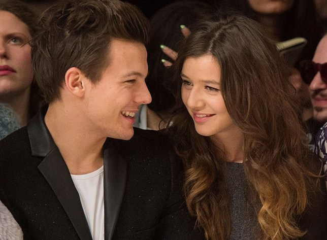 LONDON, ENGLAND - FEBRUARY 17: Louis Tomlinson of One Direction and Eleanor Calder attend the Topshop Unique show at the Tate Modern during London Fashion Week Fall/Winter 2013/14 on February 17, 2013 in London, England. (Photo by Samir Hussein/Getty Images)