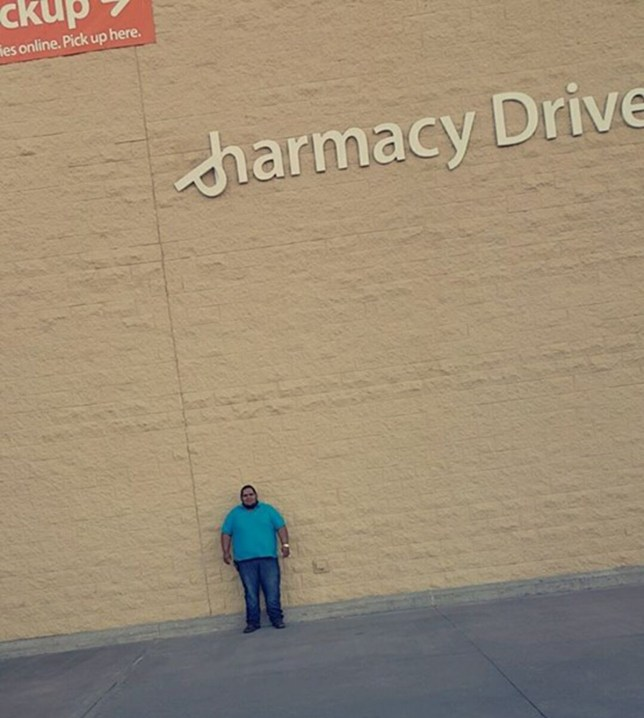 (Picture: Facebook/ Manuel Garcia) Man stands under dangling supermarket sign for two days hoping to get hit to sue them