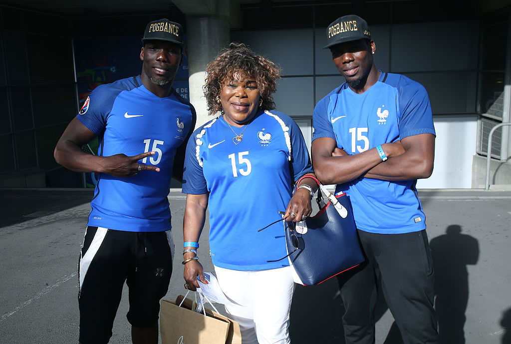 PARIS, FRANCE - JULY 10: Yeo Pogba, mother of Paul Pogba of France, and her two other sons Florentin Pogba and Mathias Pogba attend the UEFA Euro 2016 final match between Portugal and France at Stade de France on July 10, 2016 in Saint-Denis near Paris, France. (Photo by Jean Catuffe/Getty Images)