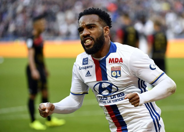 Lyon's French forward Alexandre Lacazette reacts after scoring a goal during the French L1 football match Olympique Lyonnais against EA Guingamp on October 22, 2016, at the Parc Olympique Lyonnais in Decines-Charpieu near Lyon, southeastern France. / AFP / PHILIPPE DESMAZES (Photo credit should read PHILIPPE DESMAZES/AFP/Getty Images)
