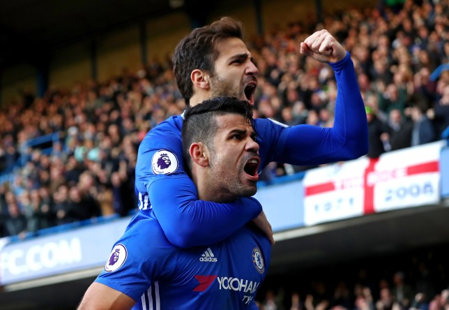 LONDON, ENGLAND - DECEMBER 11: Diego Costa (bottom) of Chelsea celebrates scoring the opening goal with his team mate Cesc Fabregas (top) during the Premier League match between Chelsea and West Bromwich Albion at Stamford Bridge on December 11, 2016 in London, England. (Photo by Clive Rose/Getty Images)
