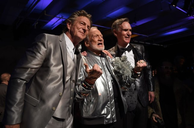 Former NASA astronaut Buzz Aldrin, lunar module pilot on Apollo 11 and second man to walk on the Moon, poses with Nick Graham (L) and Bill Nye (R) after Walking the runway duringthe Nick Graham fashion show during New York Fashion Week Men's (NYFW) in New York January 31, 2017. The show is space-themed and titled Life on Mars F/W 2035. / AFP / TIMOTHY A. CLARY (Photo credit should read TIMOTHY A. CLARY/AFP/Getty Images)