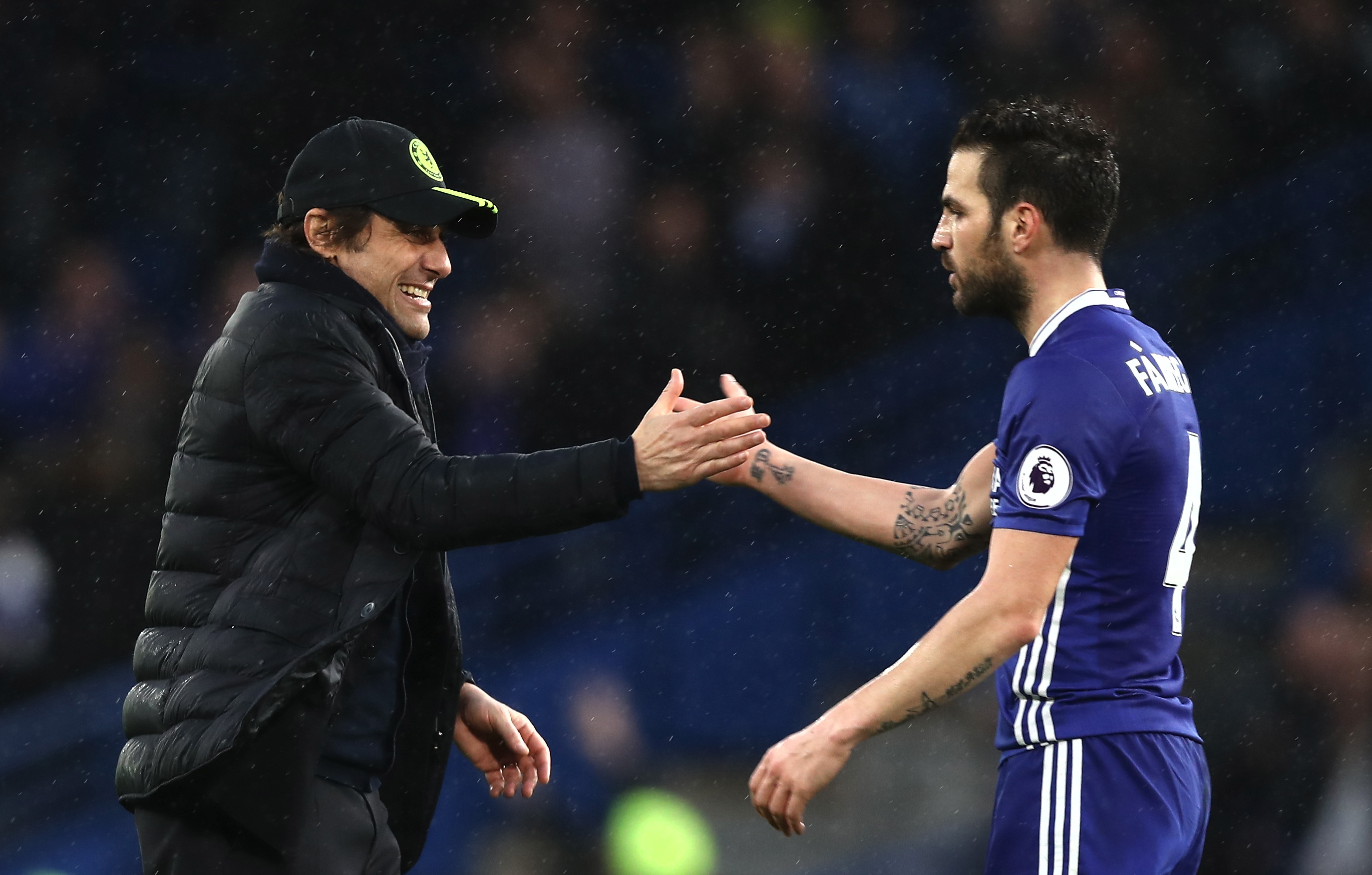 LONDON, ENGLAND - FEBRUARY 25:  Antonio Conte, Manager of Chelsea (L) and Cesc Fabregas of Chelsea (R) embrace after the Premier League match between Chelsea and Swansea City at Stamford Bridge on February 25, 2017 in London, England.  (Photo by Clive Rose/Getty Images)