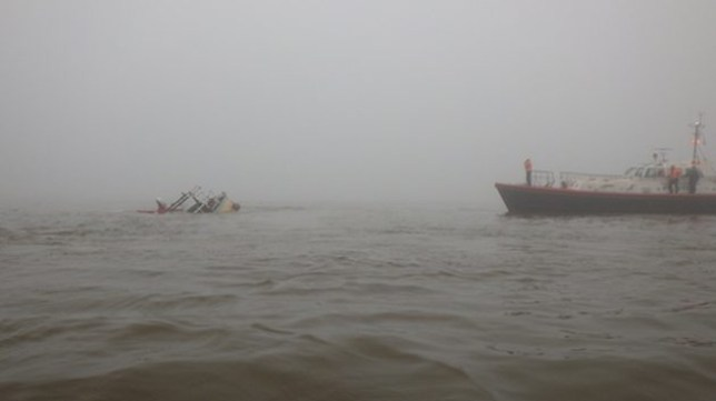 WEB_The-pilot-boarding-vessel-Venus-alongside-the-sinking-motor-vessel-and-Cleethorpes-RNLI-recovering-the-liferaft.-Credit-RNLI-Cleethorpes-630x354.jpg Peggotty Picture: RNLI-Cleethorpes