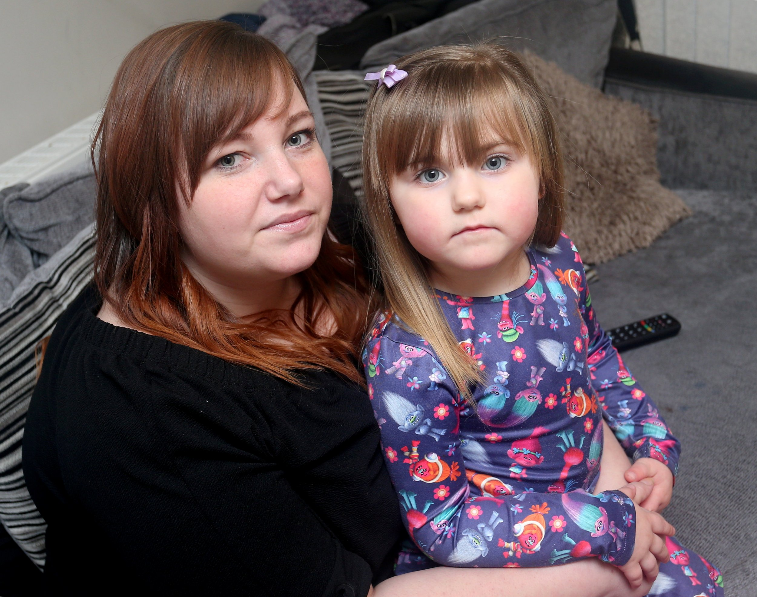 "(L- R) Tammy Dundon, 26 and her daughter Sophia Wood, 3, pictured at home in Bulwell. An angry mum says her daughter could have died after finding a battery inside a chocolate Easter bunny. See NTI story NTIBUNNY. The Co-op is now recalling its own-brand hollow milk chocolate Easter bunny foil figures after an alleged tampering incident in Nottingham. The National Crime Agency has also stepped in following the scare, as the Co-op says it is a ""criminal matter"". Tammy-Louise Dundon from Bulwell, Nottingham, bought one of the £1 treats from the branch in Arnold Road, Bestwood, on Saturday, for her three-year-old daughter Sophia Wood. She says the youngster bit the ears off the rabbit, only to find a single-cell battery, similar to those found in hearing aids, inside the hollow rabbit. It comes after a similar incident at Christmas, which resulted in chocolate Santas being recalled due to batteries being found inside the products."