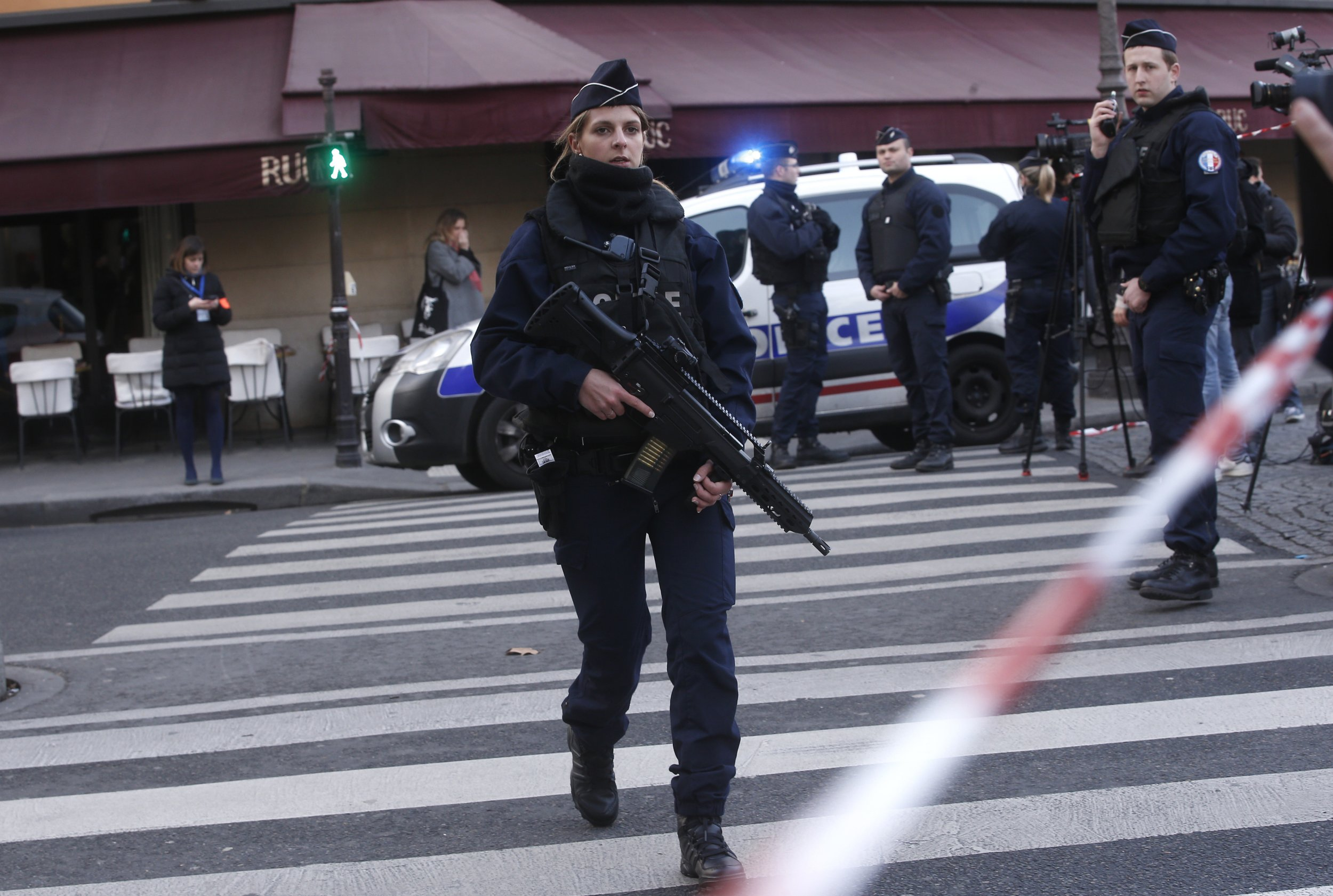 Police officers take position outside the Louvre museum in Paris,Friday, Feb. 3, 2017. Paris police say a soldier has opened fire outside the Louvre Museum after he was attacked by someone, and the area is being evacuated. (AP Photo/Thibault Camus)