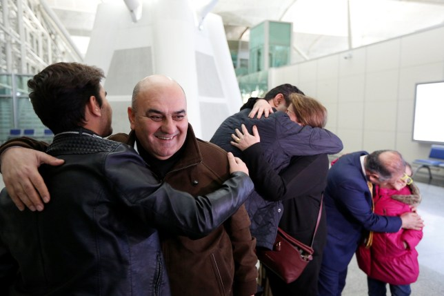 Fuad Sharef, an Iraqi with an immigration visa who was prevented with his family from boarding a flight to New York a week ago, hug his relatives goodbye at Erbil International Airport, Iraq February 4, 2017, to fly, on Turkish Airlines, to Nashville, Tennessee, their new home. REUTERS/Ahmed Saad