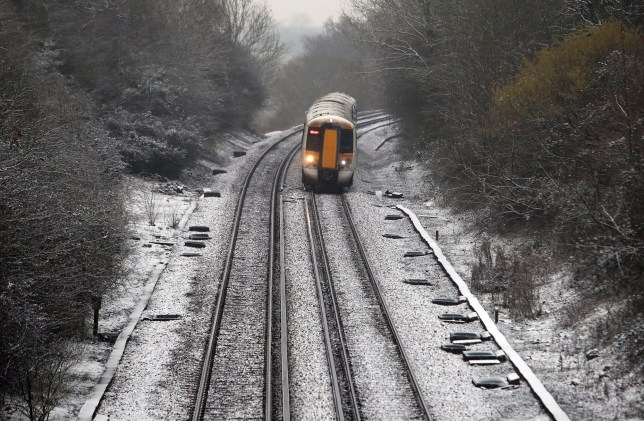 A train travels through wintry conditions the snow near Westwell Leacon in Kent as Britons heading out this weekend should brace themselves for bitterly cold conditions as the country is lashed by icy winds and snow. PRESS ASSOCIATION Photo. Picture date: Saturday February 11, 2017. See PA story WEATHER Cold. Photo credit should read: Steve Parsons/PA Wire