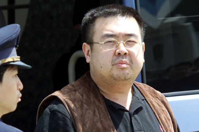 (Picture: Getty Images) (FILES) This file photo taken on May 4, 2001 shows an immigration officer (L) escorting Kim Jong-Nam, son of North Korean leader Kim Jong-Il, getting off a bus to board an ANA905 (All Nippon Airways) airplane at Narita airport near Tokyo. Kim Jong-Nam, the half-brother of North Korean leader Kim Jong-Un has been assassinated in Malaysia, South Korea's Yonhap news agency said on February 14, 2017. / AFP PHOTO / TOSHIFUMI KITAMURATOSHIFUMI KITAMURA/AFP/Getty Images
