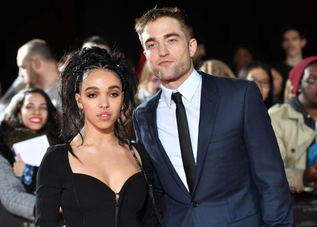 "English actor Robert Pattinson and English singer Tahliah Debrett Barnett, also known as FKA Twigs, pose upon arrival at the UK premiere of the film ""The Lost City Of Z"" at The British Museum in London on February 16, 2017. / AFP PHOTO / Ben STANSALLBEN STANSALL/AFP/Getty Images"