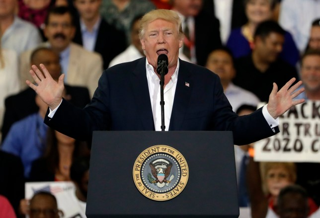 """President Donald Trump gestures during his """"Make America Great Again Rally"""" at Orlando-Melbourne International Airport Saturday, Feb. 18, 2017, in Melbourne, Fla. (AP Photo/Chris O'Meara)"""