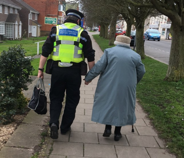 "A heartwarming picture of a PCSO taking an elderly woman by the hand after she got lost has gone viral. See NTI story NTIHELP; PCSO Dave Bunker, 49, has been widely applauded online after being seen assisting with a heavy shopping bag in Skegness, Lincs. The elderly woman had been looking for a bus stop but got lost and was faced with the prospect of a long walk home before PCSO Bunker's act of kindness. Lincolnshire Police posted the image, taken by Inspector Colin Haigh, on Twitter and it quickly spread, with more than 20,000 people viewing and sharing it around the world. Insp Haigh wrote: ""Community Policing at its best, @PCSO_Bunker helping a lady who's lost her way and can't find the bus stop."""