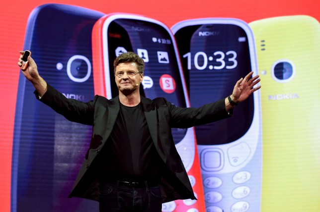 """HMD global CEO Arto Nummela presents his company's new phone """"Nokia 3310"""" during a press conference on February 26, 2017 on the eve of the start of the Mobile World Congress. Phone makers will seek to seduce new buyers with even smarter Internet-connected watches and other wireless gadgets as they wrestle for dominance at the world's biggest mobile fair starting tomorrow. / AFP PHOTO / Josep LagoJOSEP LAGO/AFP/Getty Images"""