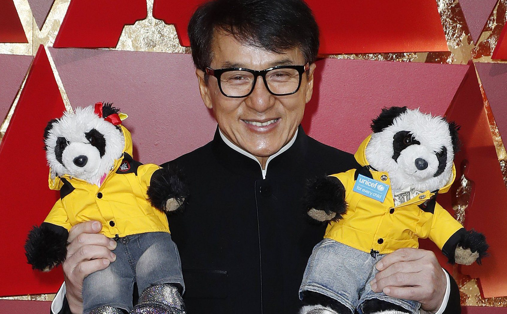 Jackie Chan brought two cuddly panda toys on to the Oscars red carpet