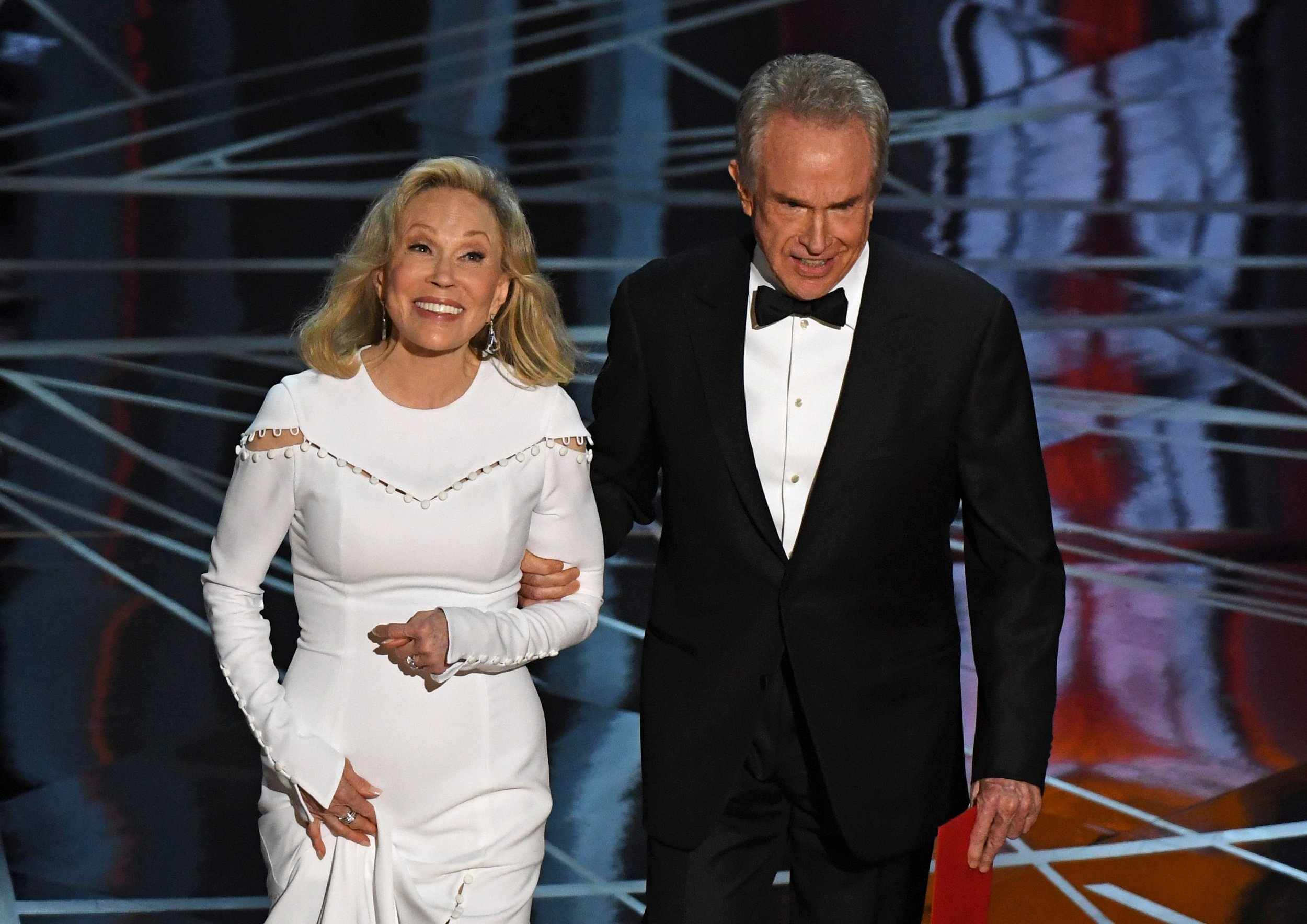 Actress Faye Dunaway and actor Warren Beatty arrive on stage to announce the winner of the Best Movie category at the 89th Oscars on February 26, 2017 in Hollywood, California. / AFP PHOTO / Mark RALSTONMARK RALSTON/AFP/Getty Images