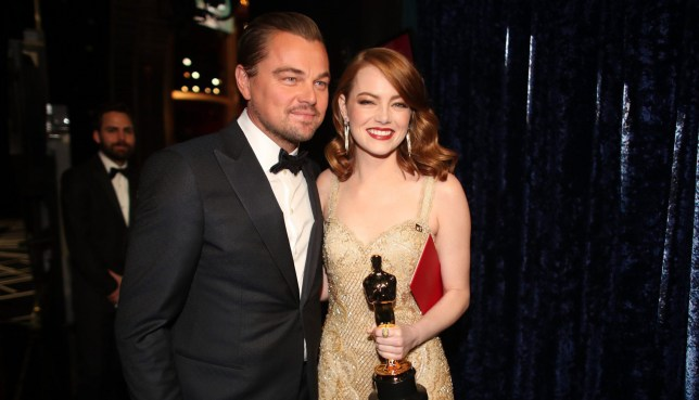 HOLLYWOOD, CA - FEBRUARY 26: Actor Leonardo DiCaprio (L) and actress Emma Stone, winner of Best Actress for 'La La Land' pose backstage during the 89th Annual Academy Awards at Hollywood & Highland Center on February 26, 2017 in Hollywood, California. (Photo by Christopher Polk/Getty Images)