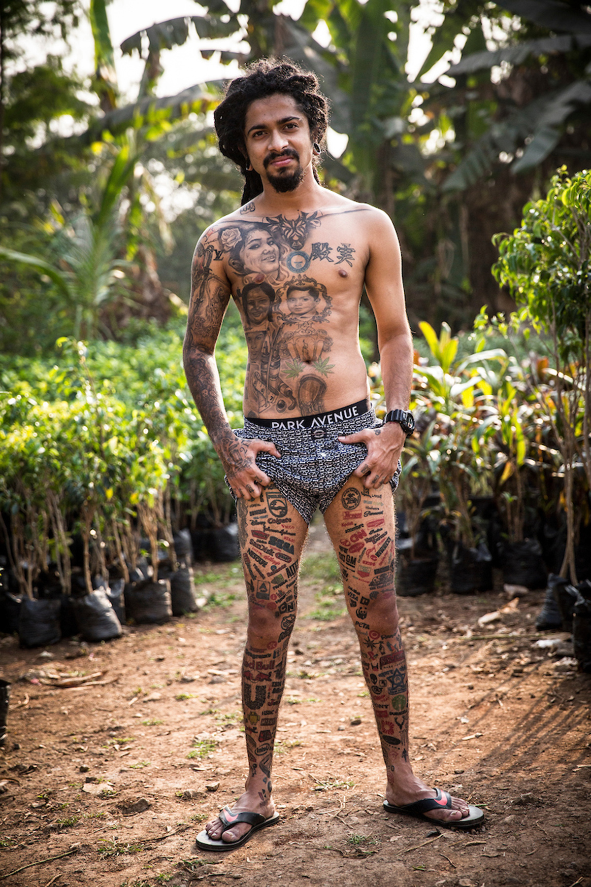 Jason George, 25, has over 400 logo tattoos (Picture: Cover Asia Press/Faisal Magray)