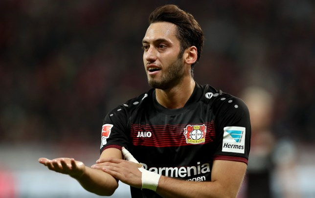 LEVERKUSEN, GERMANY - JANUARY 28:  Hakan Calhanoglu of Bayer Leverkusen gestures during the Bundesliga match between Bayer 04 Leverkusen and Borussia Moenchengladbach at BayArena on January 28, 2017 in Leverkusen, Germany.  (Photo by Lars Baron/Bongarts/Getty Images)