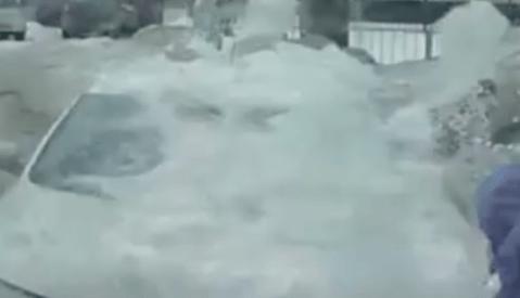 The terrifying moment falling ice block nearly kills two men