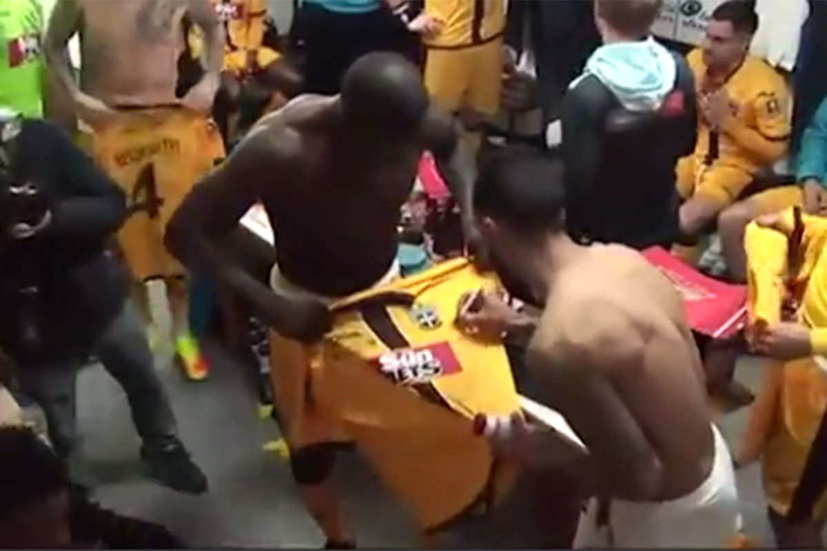 Theo Walcott redeems himself after pre-match snub by signing Sutton players' shirts in dressing room