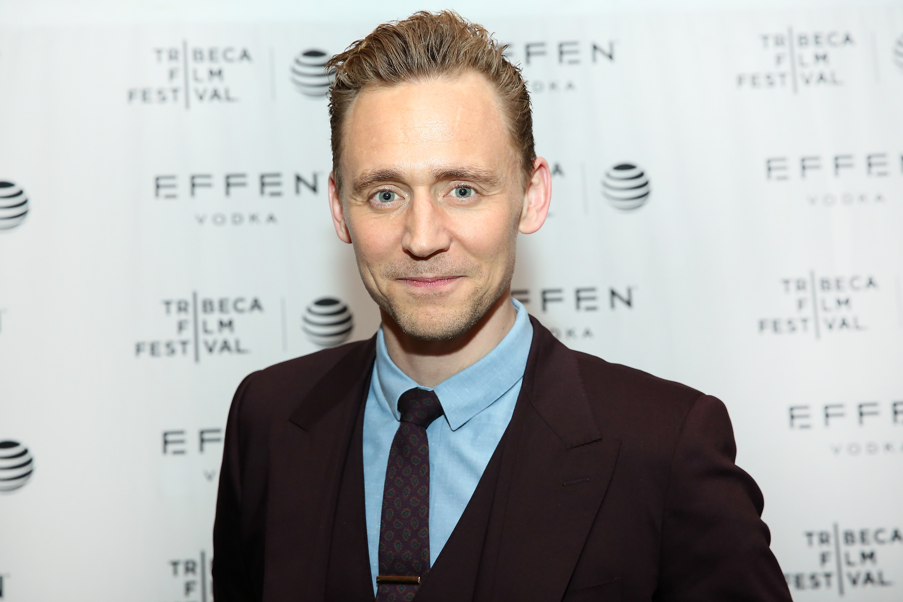 Tom Hiddleston says friends and family members have helped him survive the pressures of fame (Picture: Getty Imagesl)