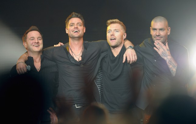 Ronan Keating (3rd L) says he's been planing a Boyzone reunion to celebrate the band's 25th anniversary with Mikey Graham (L), Keith Duffy (2nd L) and Shane Lynch (R) (Picture: Getty Images)