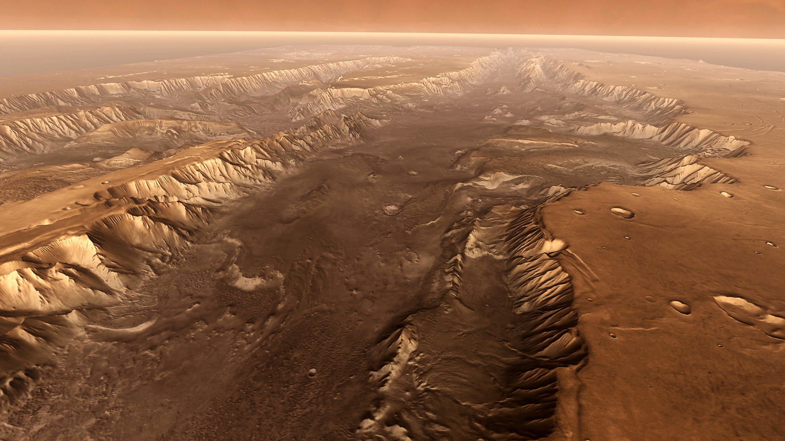 Valles Marineris, Mars, 3D image based on satellite data. Perspective view of Melas Chasma, one of the main canyons forming part of Valles Marineris, the largest canyon system on Mars. The canyon system is thought to have been formed by a combination of tectonic activity and water erosion. The canyon walls are many kilometres high, and the canyon seen here is hundreds of kilometres wide, dwarfing similar canyons on Earth. This image was generated using infrared data from the Mars Odyssey spacecrafts Thermal Emission Imaging System, and topographical data from the Mars Global Surveyor spacecrafts Mars Orbiter Laser Altimeter, both of which are in orbit around Mars.