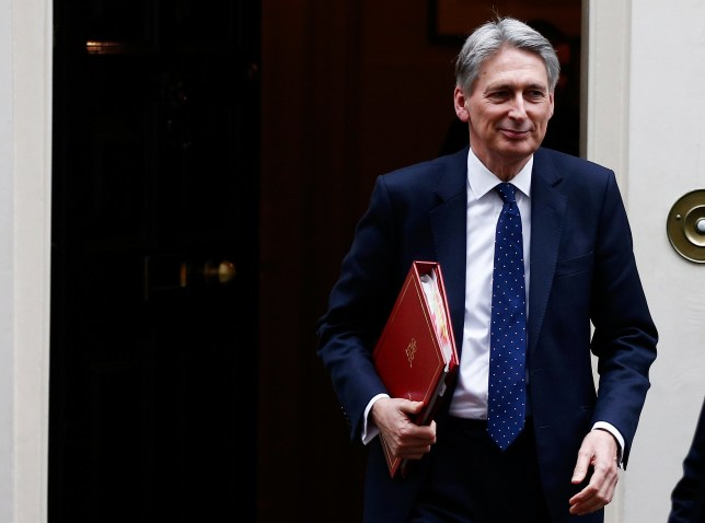 FILE PHOTO:Britain's Chancellor of the Exchequer Philip Hammond leaves 11 Downing Street, London, January 31, 2017. REUTERS/Peter Nicholls/File Photo
