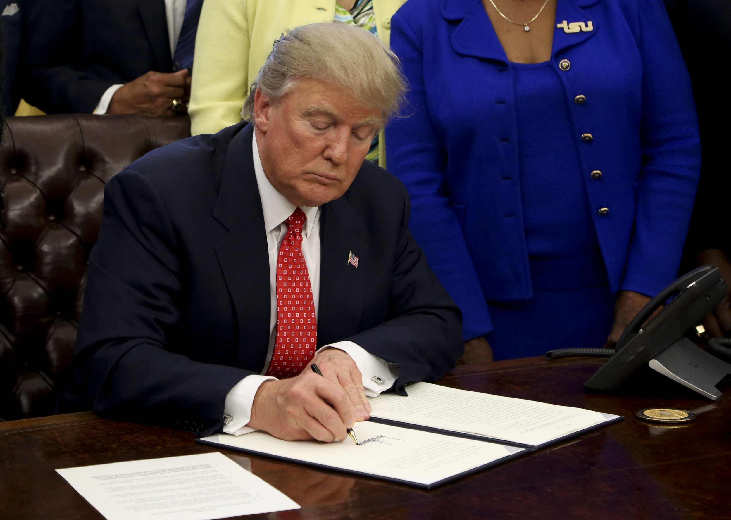 The executive orders Trump didn't want you to see him signing