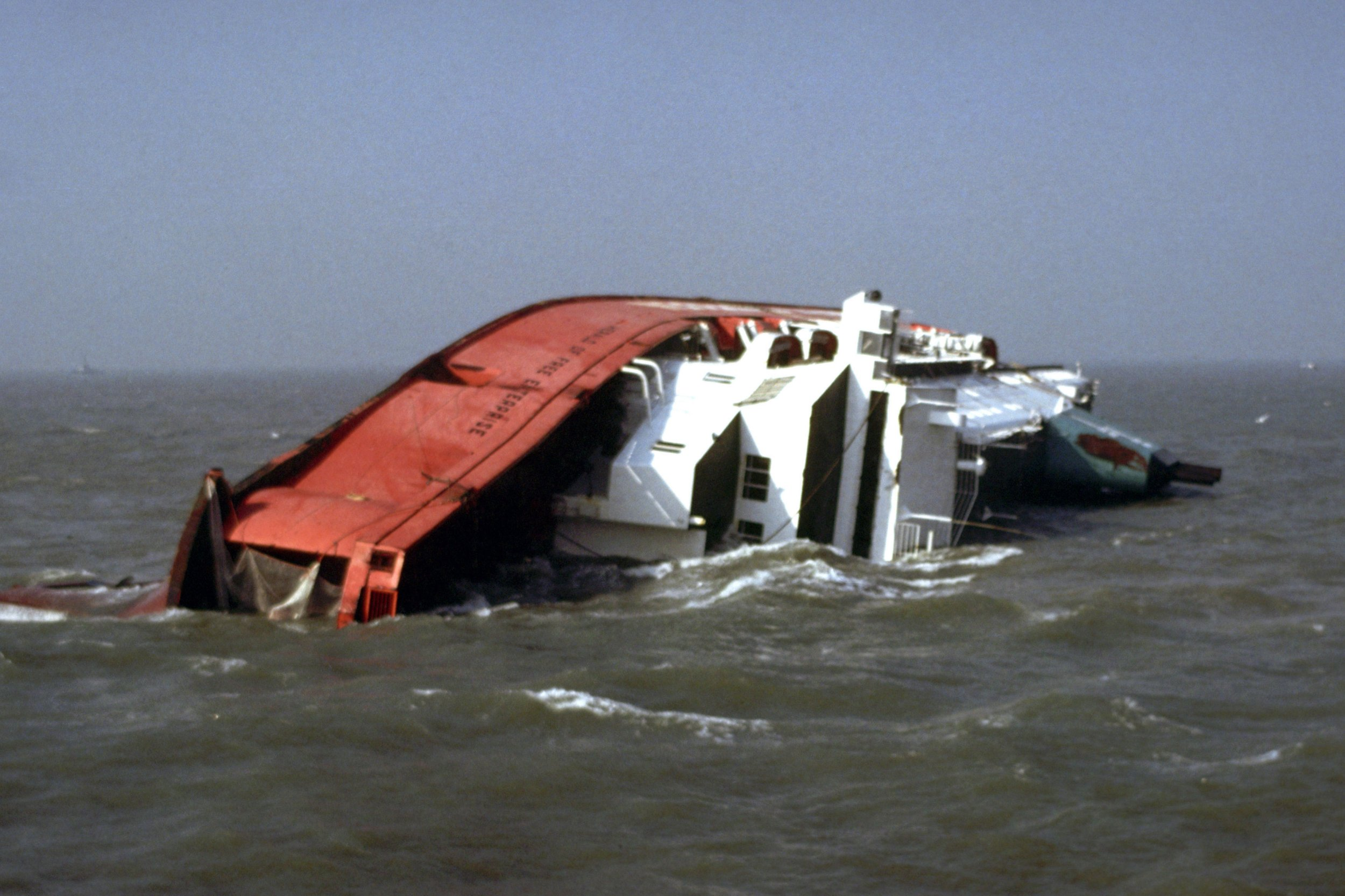 File photo dated 07/03/87 of the Townsend Thorensen car ferry Herald of Free Enterprise, which capsized near the entrance to Zeebrugge Harbour, Belgium, on its way to Dover. 193 people lost their lives in the disaster. PRESS ASSOCIATION Photo. Issue date: Sunday March 5, 2017. See PA story MEMORIAL Zeebrugge. Photo credit should read: PA/PA Wire