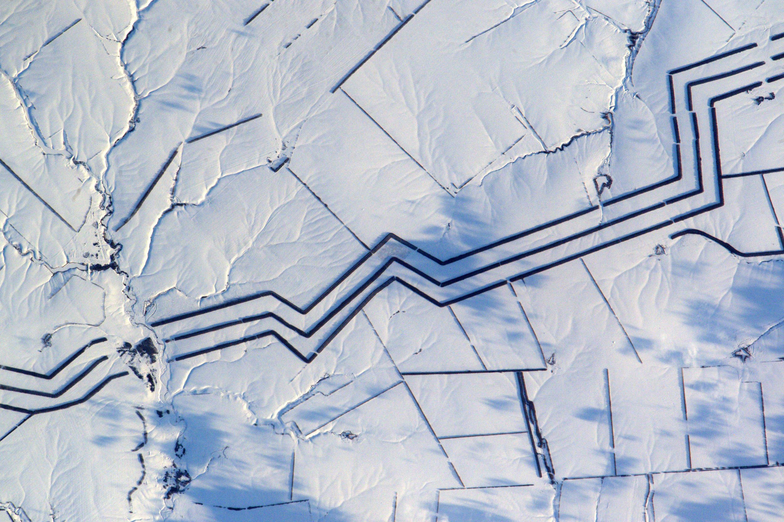 "PICTURE SHOWS: Thomas Pesquet says: ""Minimalist snow art in Russia. I cannot explain these km-long parallel lines"" ....... They look like vibrant abstract artworks - instead these are jaw-dropping images of our beautiful Earth. These are the stunning views French astronaut Thomas Pesquet has captured withing the last few months - including a night-time image of Dublin for St Patrick's Day. They range from what Thomas calls the ""minimalist snow art"" of Russian fields to the reds of the Sahara desert ""as if the paint had flowed over tens of kilometres"". When: 16 Feb 2017 Credit: Thomas Pesquet/ESA/NASA/Cover Images **All usages and enquiries, please contact Glen Marks at glen.marks@cover-images.com - +44 (0)20 3397 3000.All usages and enquiries, please contact Glen Marks at glen.marks@cover-images.com - +44 (0)20 3397 3000.CREDIT: Thomas Pesquet/ESA/NASA/Cover Images. Editorial use only**"