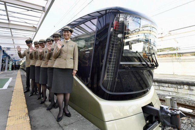 Crew members pose for a photo after East Japan Railway Co.'s Train Suite Shiki-Shima luxury sleeper train arrives at JR Nikko Station in Nikko, Tochigi Prefecture, during a trial run on Dec. 5, 2016. Passengers on the train set to begin operation in May 2017 will also be offered use of an exclusive lounge at JR Ueno Station in Tokyo. (Kyodo)n==Kyodon(Photo by Kyodo News via Getty Images)