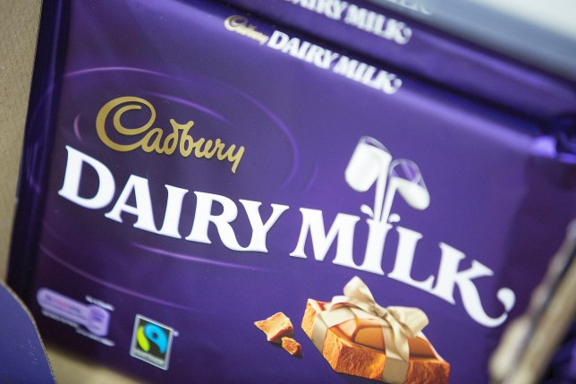 """Multi-pack bars of Cadbury """"Dairy Milk"""" chocolate, manufactured by Kraft Foods Inc., sit displayed for sale inside an Asda supermarket, the U.K. retail arm of Wal-Mart Stores Inc., in Watford, U.K., on Thursday, Oct. 17, 2013. U.K. retail sales rose more than economists forecast in September as an increase in furniture demand led a rebound from a slump the previous month. Photographer: Simon Dawson/Bloomberg via Getty Images"""