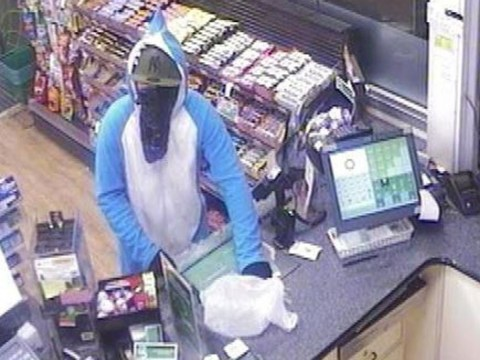 Armed man robs petrol station while wearing a shark onesie