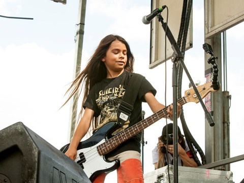Korn has hired a 12 year old boy to perform on their South America tour