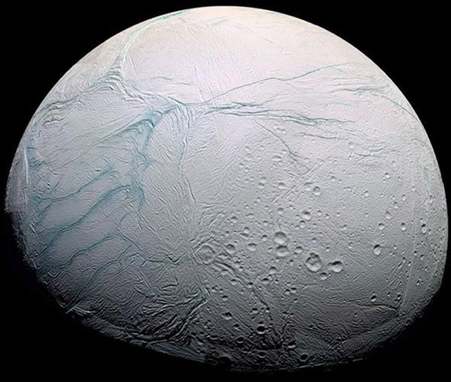 """BEST QUALITY AVAILABLE Undated Nasa handout photo of one of Saturn's moons, Enceladus. Life could exist on Enceladus around hydrothermal vents similar to those found at the bottom of Earth's oceans, scientists believe. PRESS ASSOCIATION Photo. Issue date: Thursday April 13, 2017. The """"exciting"""" discovery was made after the space probe Cassini flew through spray bursting from the moon's cracked icy surface. Chemical analysis of the plume suggested conditions favourable for methanogenesis - the generation of methane by microbes that use hydrogen and carbon dioxide to obtain energy. See PA story SCIENCE Enceladus. Photo credit should read: JPL/Nasa/PA Wire NOTE TO EDITORS: This handout photo may only be used in for editorial reporting purposes for the contemporaneous illustration of events, things or the people in the image or facts mentioned in the caption. Reuse of the picture may require further permission from the copyright holder."""