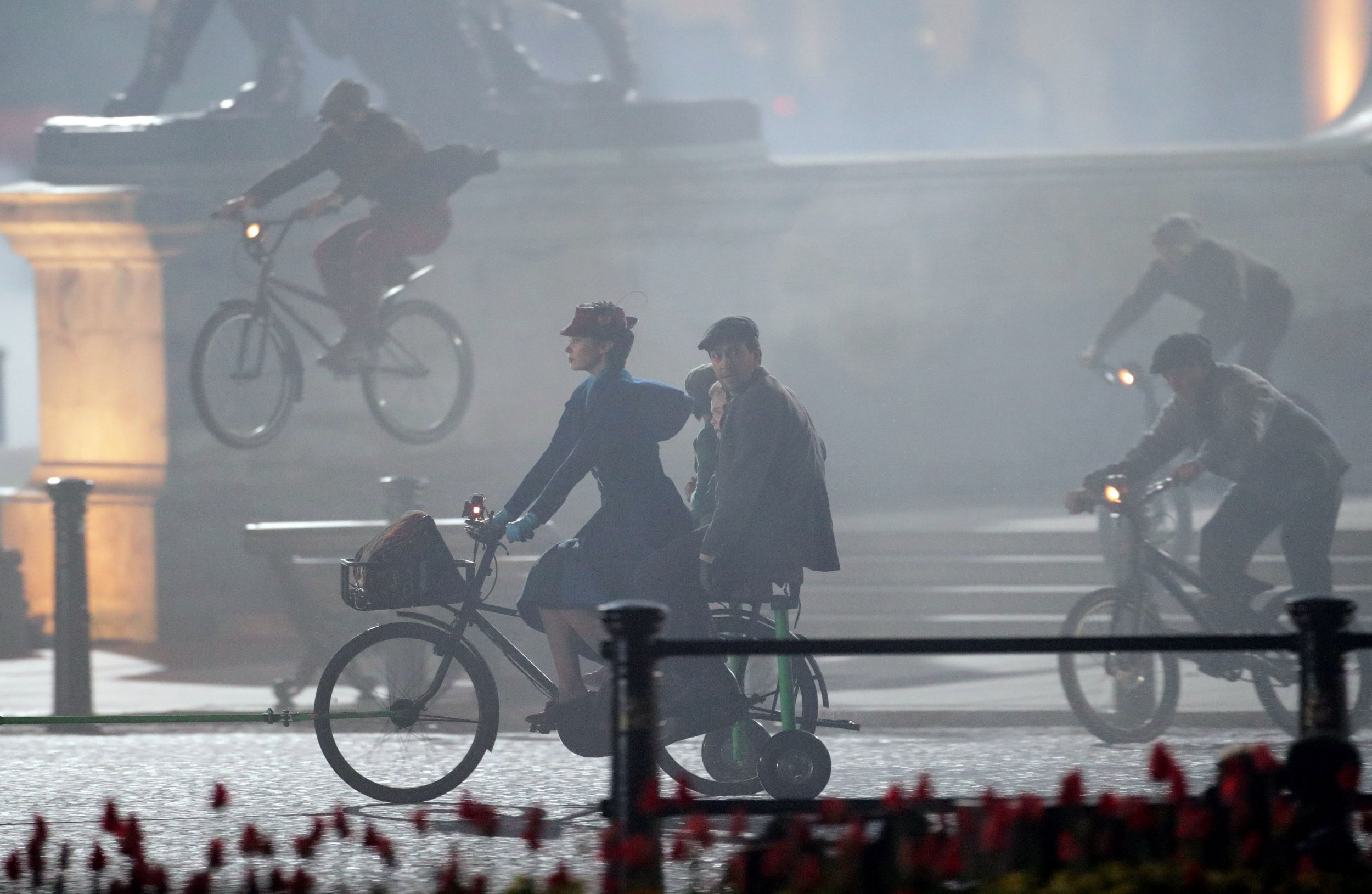 Emily Blunt films Mary Poppins Returns in front of Buckingham Palace complete with flying bicycles