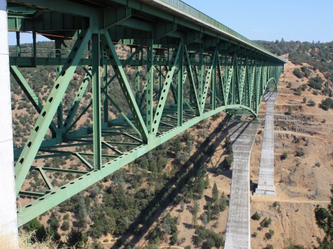 Woman miraculously survives falling off California's highest bridge while taking selfie