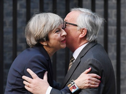 Theresa May greets Jean-Claude Juncker with kiss on cheek for Brexit talks