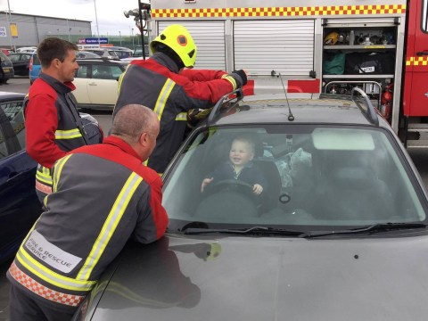 Toddler really enjoys being rescued by firemen from locked car
