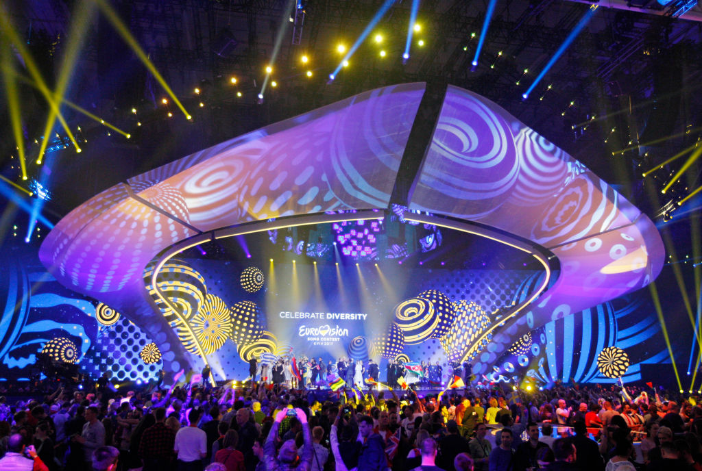 Participants celebrate making into the final during the First Semi Final of the Eurovision Song Contest, in Kiev, Ukraine
