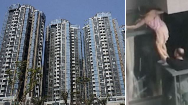 Woman cleans window on seventh floor without safety harness