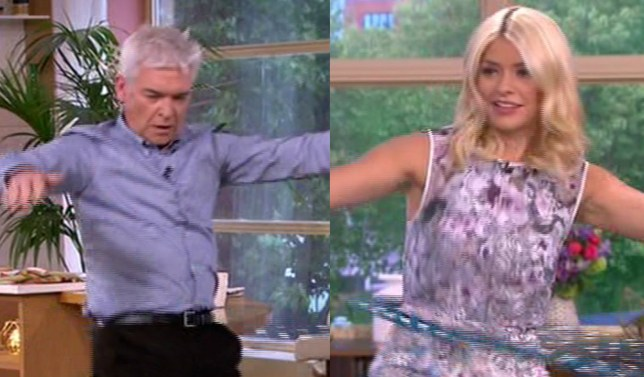 This Morning's Holly and Phillip took up hula-hooping in the final moments of the programme (Picture: ITV)