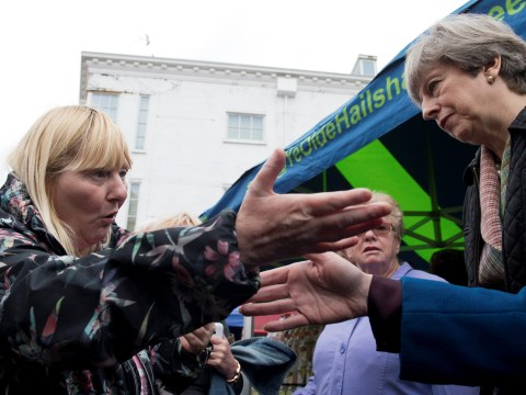 Theresa May confronted by angry voter who had her disability benefits cut