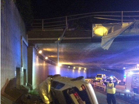 Car with family inside crashes through barrier onto road below