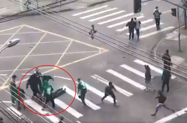 One hooligan had to be dragged away after stamping on the defenseless man's head several times (Picture: Screengrab/SCCP)
