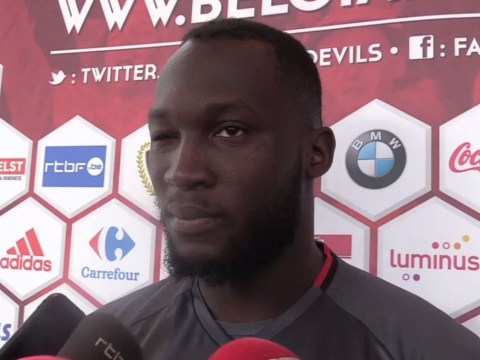 Manchester United target Romelu Lukaku winks when pressed on Chelsea transfer speculation